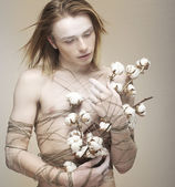 Bloke. Daydreaming Young Man holding Bouquet of Flowers. Cotton — Stock Photo