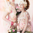 Stock Photo: Freshness. Two Young Pretty Women in Classic Vintage Dresses with Flowers. Pin-up Style