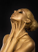 Coloring. Gilt. Golden Plated Woman's Face. Art concept. Gilded Body. Focus on her hands — Stock Photo