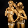 Body Art. Woman painting Body with Paint Brush in Golden Color. Gold Make Up — Stock Photo #22057015