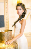 Luxurious Posh Brunette in White Dress. Oriental Antique Golden Decor — Stock Photo
