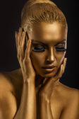 Face Art. Fantastic Gold Make Up. Stylized Colored Woman's Body — Stockfoto