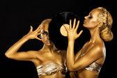 Fetish. Women DJs holding Retro Vinyl Record. Fantastic Gold Badyart. Performance — Stock Photo