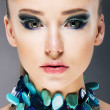 Stock Photo: Glamorous Confident Womin Semi Precious Turquoise Necklace close up