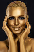 Coloring & Glance. Gorgeous Woman smiling. Fantastic Golden Makeup. Art — Stock Photo