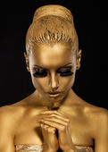 Belief. Styled Woman with praying hands. Golden Makeup — Stock Photo