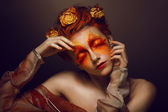 Bodyart. Imagination. Artistic Woman with Red - Gold Makeup and Flowers. Coloring — Stock Photo