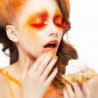 Stock Photo: Gilding. Tempting Womeating Pie with Cream. Bright Red-Golden Makeup
