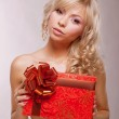 Donation. Young Beauty Blonde holding Red Box as a Present. Holiday — Stock Photo #23223654