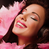 Inspiration. Fancy Cheerful and Happy Woman with pink Feathers smiling. Pleasure — Stock Photo
