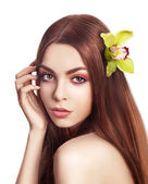 Pampering. Serene Woman with Orchid Fresh Flower in Hair. Tenderness — Stock Photo