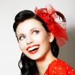 Stock Photo: Vitality. Cheerful Young Womwith Red Bow enjoying. Pleasure