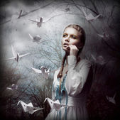 Inspiration. Woman with Flying White Origami Swans in Dark Mystic Forest — 图库照片