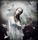 Imagination. Romantic Blonde with Hovering Origami Birds in Spooky Forest. Magic — Stock Photo