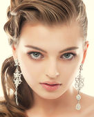 Jewelry. Portrait of Gorgeous Exquisite Woman with Shiny Earrings. Refinement — Stock Photo