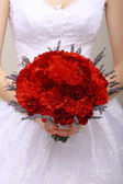 Donation. Compliment.Vernal Bouquet of Red Flowers in Woman's hands. Felicitation — Stock Photo