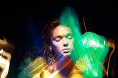 Flutter. Face of Woman in Blurry Colorful Lights. Metamorphose — Stock Photo