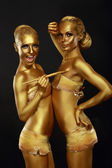 Fancy Dress Party. Couple of Women with Golden Metallic Painted Skin. Creativity — Stock Photo