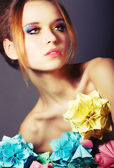 Portrait of Young Beauty with Colorful Origami Flowers. Bright Eye Make-Up — Stock Photo