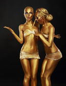 Gilt. Coloring. Two Funny Women with Paintbrush. Golden Makeup — Stock Photo