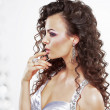 Stock Photo: Classy Elegant Womwith Jewelry - Platinum Ring and Earrings. Frizzy Hairstyle