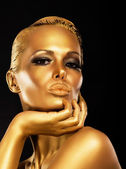 Fantasy. Face of Styled Enigmatic Woman with Gold Make-up. Luxury — Stock Photo