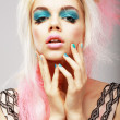 Stock Photo: Vitality. Eccentric Blond with Theatrical CyMakeup. Dyed Pink Hair