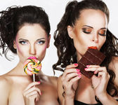 Two Beautiful Woman with Sweet - Lollipop and Chocolate Bar. Pleasure — Stock Photo