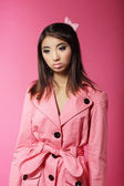 Stylish Japanese Girl in Pink Outwear over Colored Background — Stock Photo