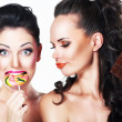 Glam. Couple of Funny Women holding Sweets. Positive Emotions. Vitality — Stock Photo