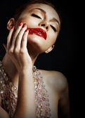 Woman with Smeared Red Lipstick over Black Background — Stock Photo