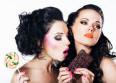 Relish. Couple of Bright Women with Sweetness - Chocolate and Lollipop — Stock Photo