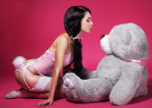 Seductive Playful Woman in Pink Lingerie with Teddy Bear — Stock Photo