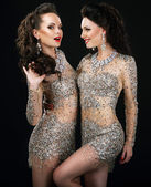 Excited Glamorous Couple in Platinum Dresses Talking — Stock Photo