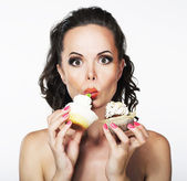 Gluttony. Hungry Funny Young Woman Greedily Eats Cakes with Cream — Stock Photo