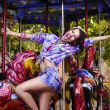 Stock Photo: Funfair. Cheerful Womin Amusement Park on Carousel. Enjoyment