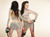 Fete. Clubbing. Two Women in Shiny Silver Dresses with Rhinestones — Stock Photo