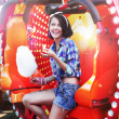 Stock Photo: Lifestyle. Young Happy WomEating Sweetened Cotton Candy in Funfair