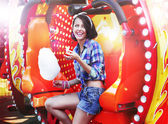 Lifestyle. Young Happy Woman Eating Sweetened Cotton Candy in Funfair — Stock Photo