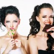 Stock Photo: Burlesque. Parody. Couple of Women Sneers and showing Fig