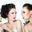 Fantasy. Woman Teasing another with Lollipop — Stock Photo