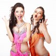 Belly Dance. Two Women in Oriental Stage Costumes Singing — Stock Photo #31368921