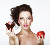 Dilemma. Diet. Undecided Woman with Apple and Cupcake — Stock Photo