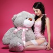 Stock Photo: Birthday. Sensual Girl with Teddy Bear Sitting and Smiling. Dearness