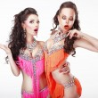 Clubbing. Two Women Showgirls in Stage Dresses — Stock Photo