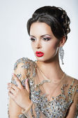 Elegance. Luxurious Good Looking Woman in Dress with Sequins and Jewels — Stock Photo