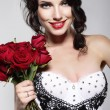 Fragrance. Beautiful Young Woman Holding Bouquet of Red roses. Valentine's Day — Stock Photo #33529423
