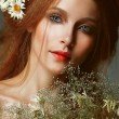 Stok fotoğraf: Pure Beauty. Auburn Girl holding Bouquet of Wildflowers. Tenderness