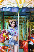 Merry-go-round. Playful Stylish Showy Woman in Roundabout. Funfair — Stock Photo