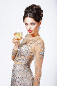 Elegant woman with a glass of champagne. — Stock Photo